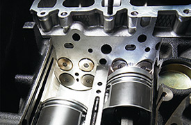 Mitsubishi L200 Triton DOHC 16 valve arrangement creates a more complete fuel and air mixture into the chamber and a flow through intake and exhaust